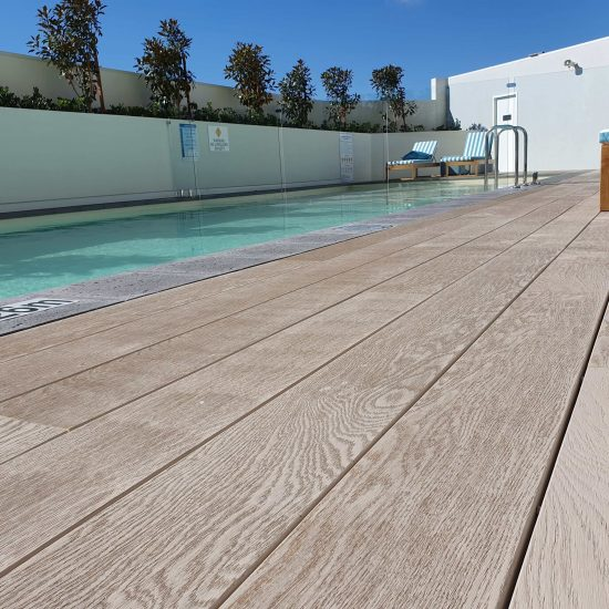 Millboard decking swimming pool side
